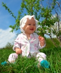 smiling baby on the grass